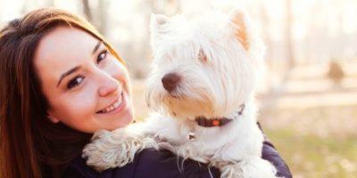 Girl holding her West Highland White Terrier